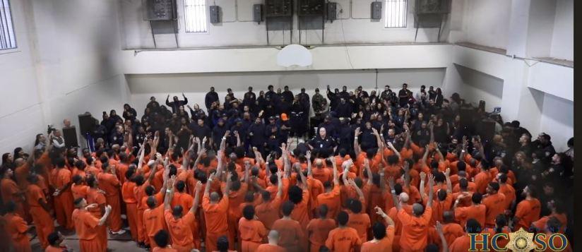 Texas inmates lifting hands